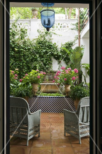 View into the green oasis of a Mediterranean patio
