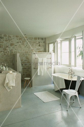 A spacious bathroom with a bathtub and a separate shower
