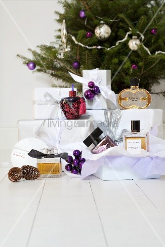 Perfume bottles and presents with Christmas decorations