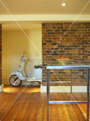 Metal table with glass top with scooter in background