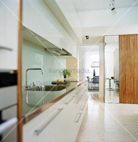 A kitchen counter with white cupboards